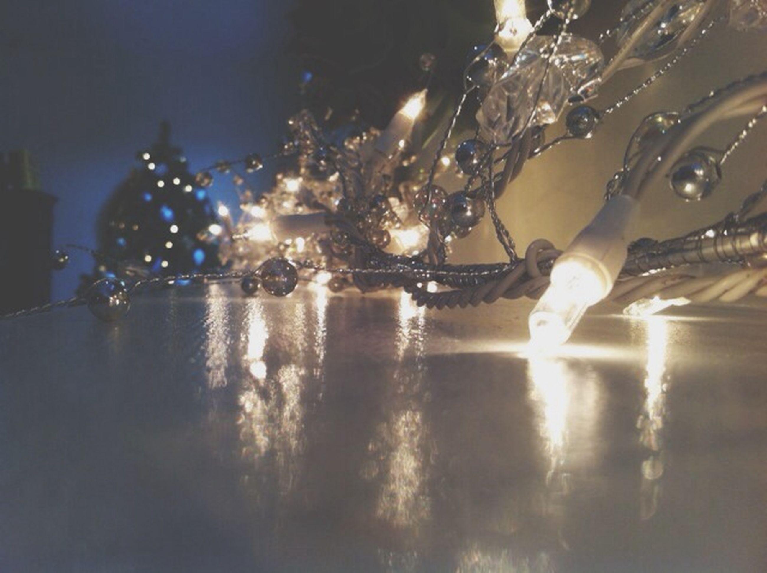 illuminated, night, water, reflection, transportation, street light, lighting equipment, mode of transport, motion, long exposure, street, waterfront, city, outdoors, land vehicle, sky, car, wet, light - natural phenomenon, glowing