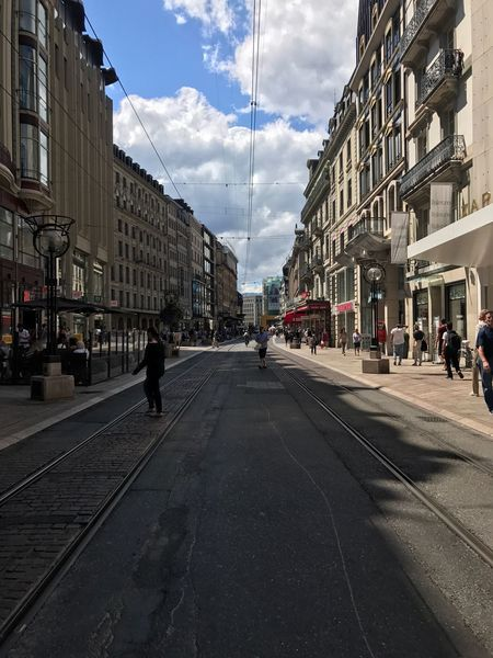 Genève Switzerland 🇨🇭 Switzerland Architecture Building Exterior Sky Built Structure Street Road Day Walking Cloud - Sky Outdoors City The Way Forward Large Group Of People Group Of People People City City Life Cityscape The Week On EyeEm Modern Travel Transportation