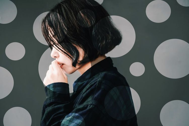 Portrait of a boy against wall