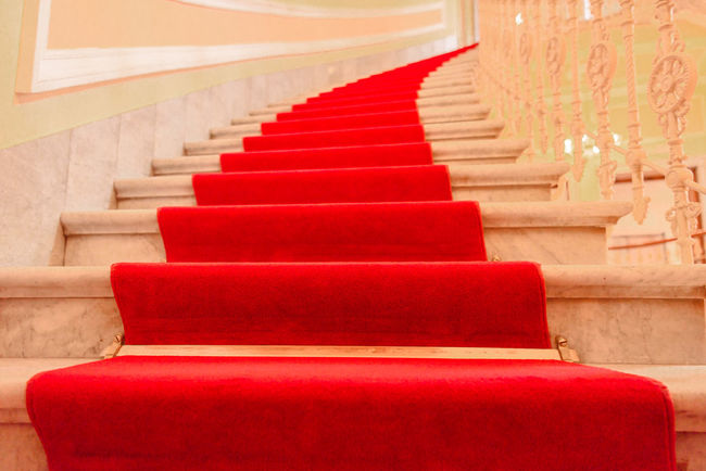 Majestic interior marble stairs from a luxury building covered with red carpet Elégance Luxury Hotel Spiral Stairs Stairway In A Row Indoors  Interior Interior Design Luxury Majestic Marble Stairs No People Red Red Carpet Red Carpet Stairs Staircase Steps Steps And Staircases