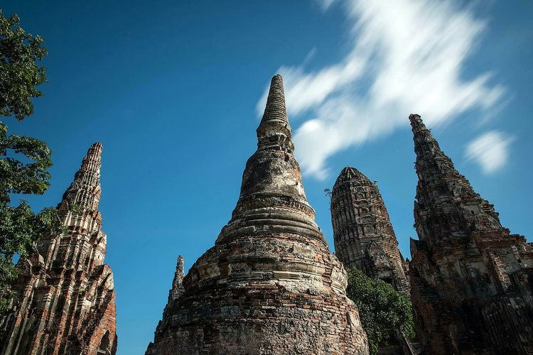 Low angle view of historic temples against sky