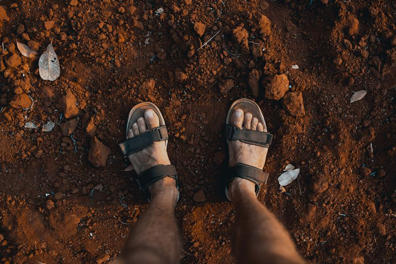 Hello Cambodia. I arrived! ASIA Cambodia Lost Red Rust The Traveler - 2018 EyeEm Awards Traveling Brown Dirt Dust Flip-flop Human Body Part Human Foot Human Leg Kopczynski Na Fali Land Men Mud Outdoors Personal Perspective Reebok Shoe Shoes Standing Traveler