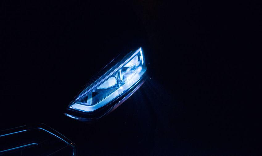High angle view of illuminated headlight of car