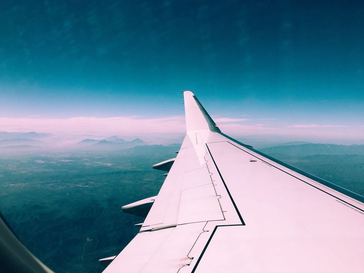 Art Is Everywhere Airplane Transportation Journey Aerial View Airplane Wing Mode Of Transport Aircraft Wing Air Vehicle Nature Sky Flying Beauty In Nature No People Scenics Mid-air Day Outdoors Tranquil Scene Blue