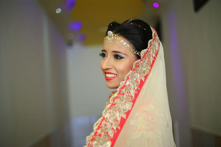 Smiling beautiful bride looking away