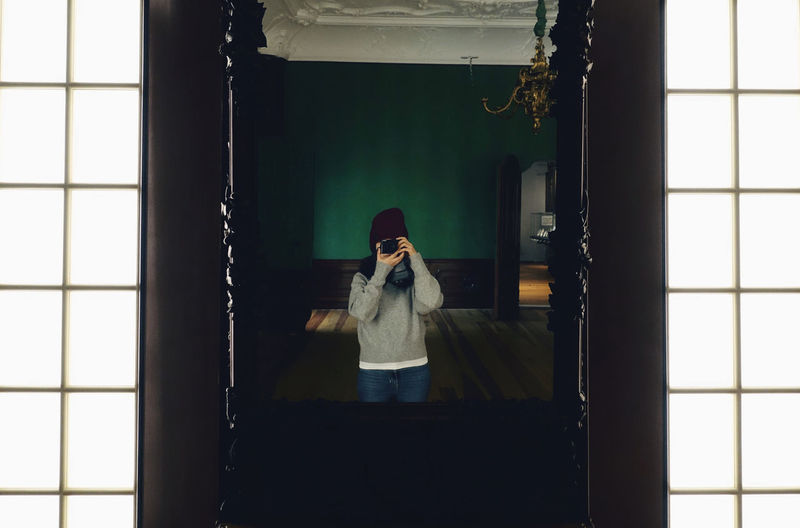 Selfie Self Portrait One Person Mirror Reflection Indoors  Lifestyles Front View Taking Photos Me Photography Room Mirror Reflection Mirrorselfie Life Warm Clothing Spring Old-fashioned Building Architecture Light Green Color Wall Real People Holding