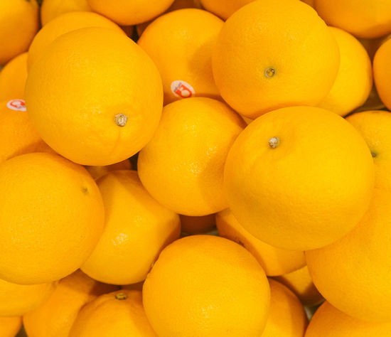 Orange Abundance Backgrounds Citrus Fruit Close-up Food Food And Drink For Sale Freshness Fruit Full Frame Healthy Eating Large Group Of Objects Market Market Stall No People Orange Orange Color Retail  Retail Display Ripe Still Life Wellbeing Yellow