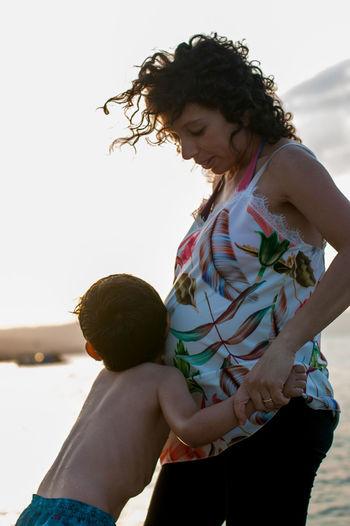 Mother and girl with arms outstretched