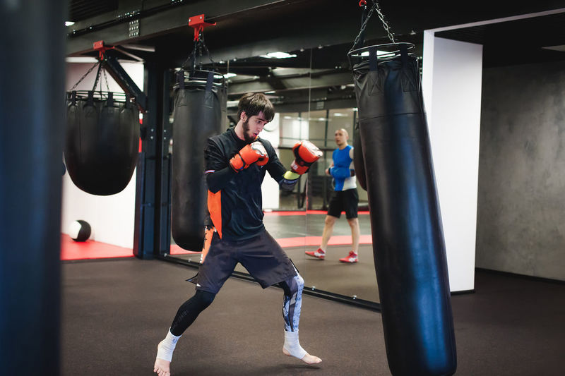 Man Practicing In Boxing Ring