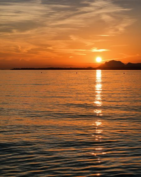 Sunset Water Sky Beauty In Nature Scenics - Nature Tranquility Sea Reflection Tranquil Scene Waterfront Cloud - Sky Orange Color Nature Idyllic Horizon Sun No People Sunlight Horizon Over Water Outdoors Freedom Romantic Sky