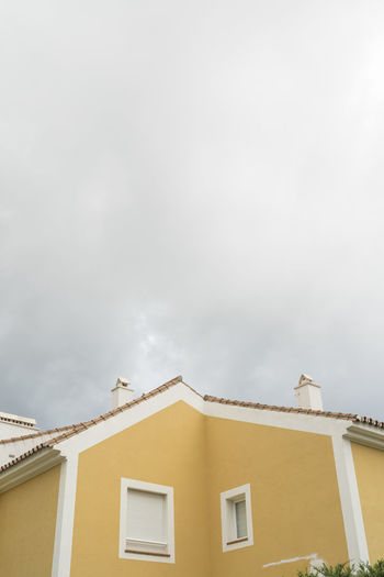 SPAIN Architecture Colours Minimalism Minimalist Architecture Building Exterior Built Structure Building Window Residential District Day Nature No People Outdoors Sky Cloud - Sky Low Angle View House City Location Place Copy Space Town Neighborhood Yellow
