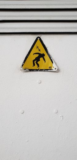 Close-up of warning sign on wall