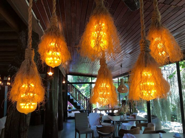 Lighting Equipment Hanging Illuminated Indoors  Ceiling No People Decoration Light Glowing Table Restaurant Low Angle View Business Burning Electric Light Architecture Built Structure Wood - Material Electricity  Orange Color Electric Lamp