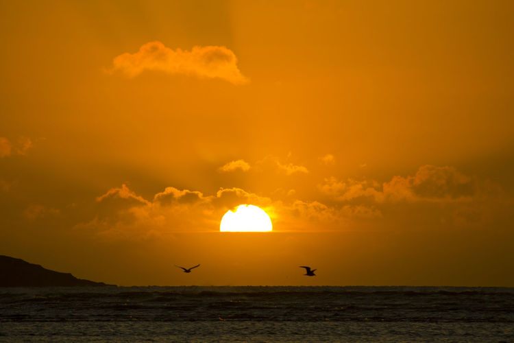 Atmosphere Atmospheric Mood Beauty In Nature Cloud Cloud - Sky Cloudscape Cloudy Distant Dramatic Sky Light Majestic Moody Sky Orange Color Outdoors Silhouette Sky Storm Cloud Sun Sunset