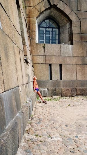 Summer in Russia Stone Fort Summer Russia Folk Simple Man Man Old Man Sun Bath Russian Full Length Window Architecture Building Exterior Built Structure