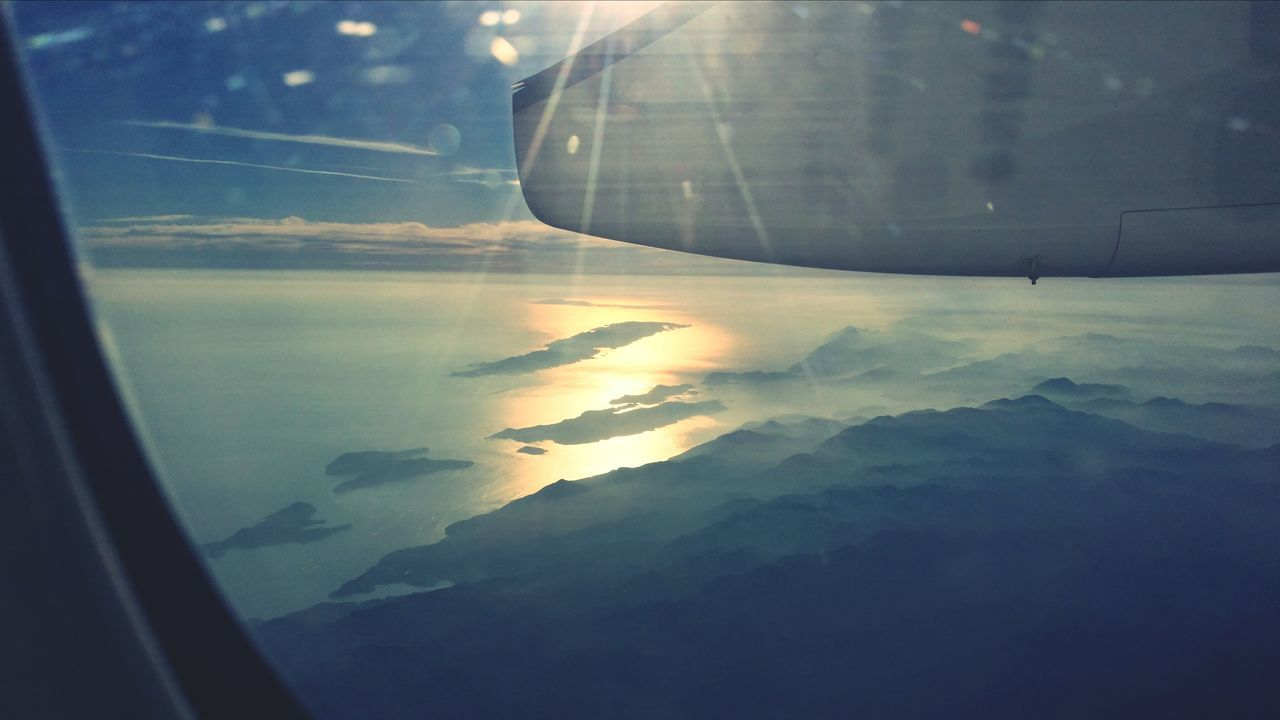 Landscape Seen From Airplane Window During Sunset