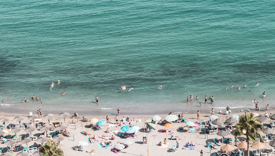 At the seashore. Beach Beach Photography Beauty In Nature Coastline Day High Angle View Large Group Of People Minimalism Nature On Vacation Outdoors People Perspective Real People Sand Sea Shore Summertime Sunny Vacations Water Wave Live For The Story Sommergefühle