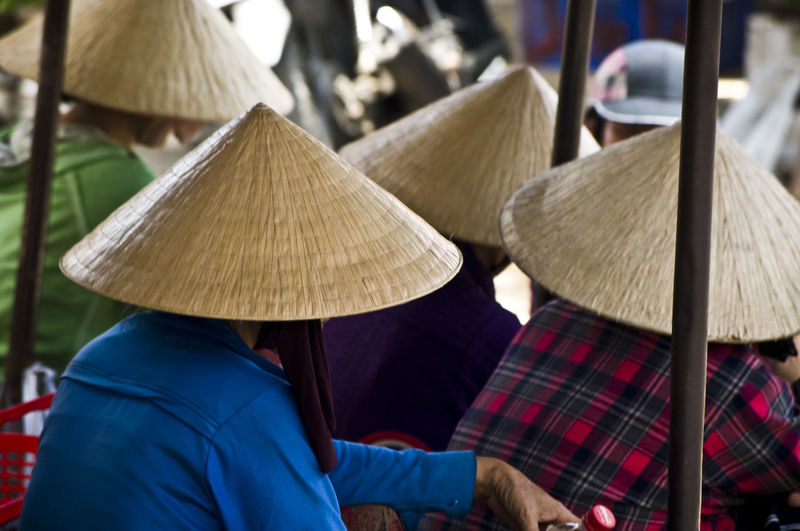 ASIA Check This Out Chinese Hat Close-up Focus On Foreground Hanging Out Hat Here Belongs To Me Hoi An Lifestyles Non La Outdoors Person Rear View Sitting Style And Fashion Togetherness Tradition Traditional Clothing Traveling Typical Vietnam Waist Up