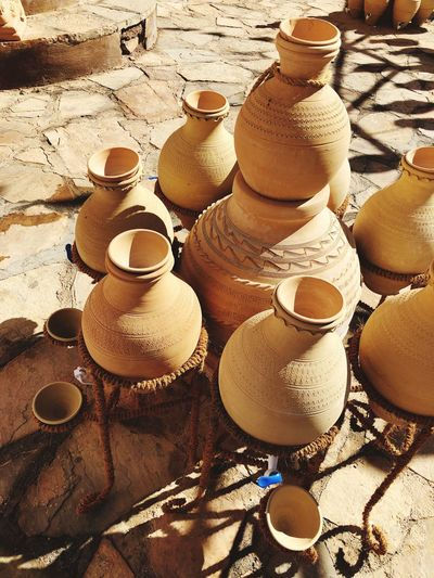Souq Souvenirs Souq Nizwa Craftsmenship Souvenirs Oman Travel Destination Tourist Shopping Old Skills Old Art Omani Craft Craft Pottery EyeEm Selects Earthenware Clay High Angle View Day Brown Sunlight Mud No People Variation