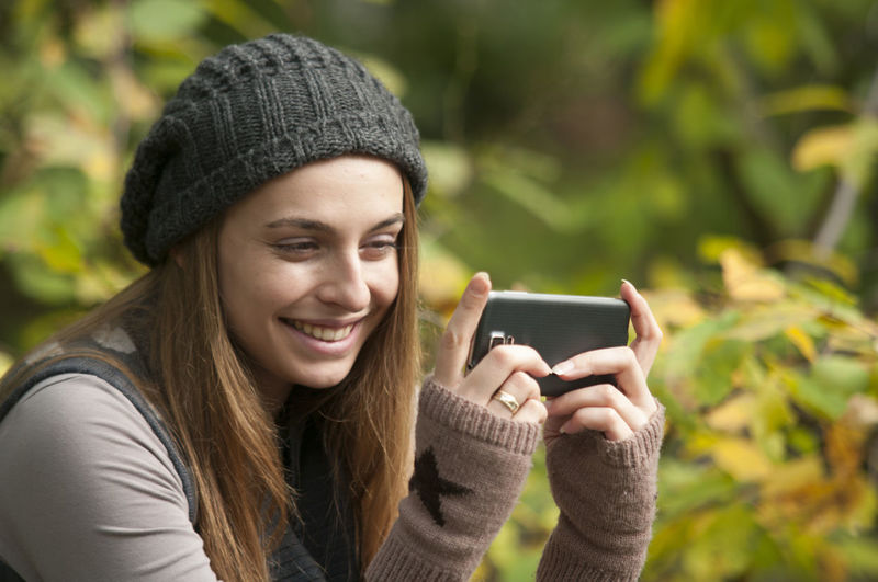 Autumn Beautiful People Beauty Casual Clothing Communication Happiness Holding Mobile Phone Model One Person People Photo Messaging Photography Themes Portable Information Device Smart Phone Smiling Technology Telephone Wireless Technology