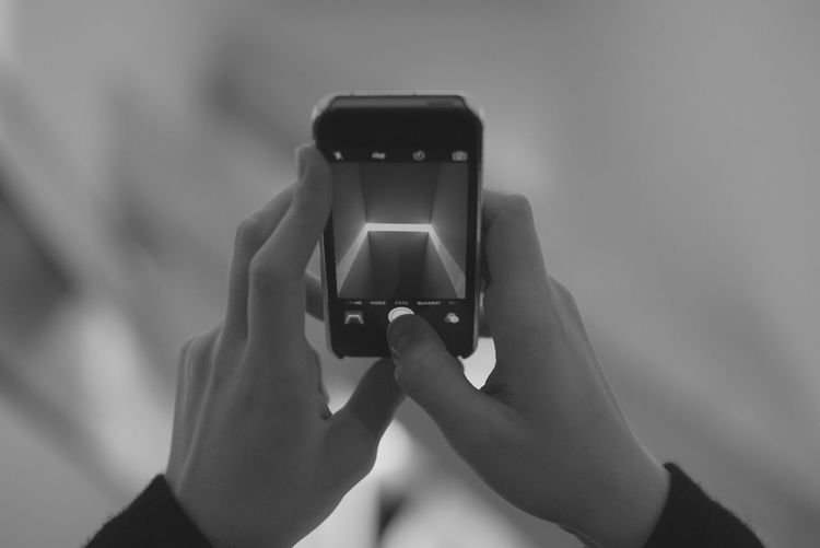 Cropped Image Of Person Photographing On Mobile Phone