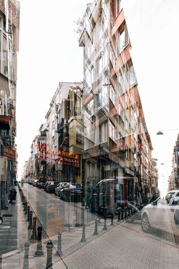 Double Exposure Apartment Architecture Building Building Exterior Built Structure Car City City Life City Street Clear Sky Day Incidental People Mode Of Transportation Motor Vehicle Nature Outdoors Place Residential District Sky Street Transportation