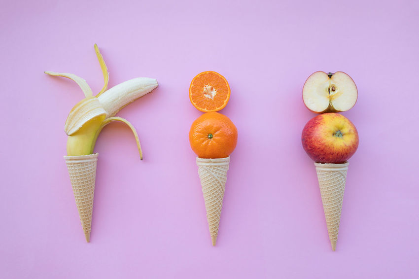 Apple - Fruit Choice Colored Background Cone Directly Above Food Food And Drink Freshness Fruit Group Of Objects Healthy Eating High Angle View Horn Ice Cream Indoors  No People Orange Orange - Fruit Orange Color Pink Background Ripe SLICE Still Life Studio Shot Wellbeing