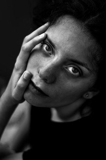 Close-Up Portrait Of Teenage Girl Over Black Background