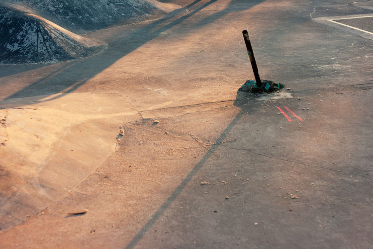 Broken bollard on footpath