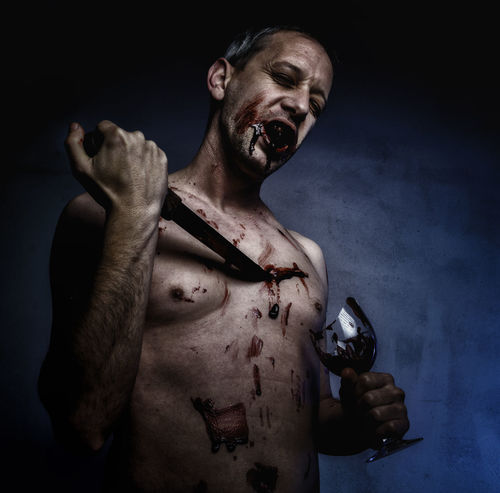 BLOODY Dark Adult Adults Only Butcher Close-up Danger Evil Halloween Holding Horror Human Body Part Looking At Camera Men One Man Only One Person People Portrait Real People Shirtless Spooky Studio Shot Young Adult