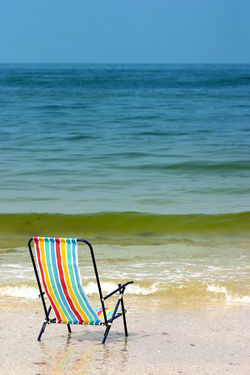 Beach Chair Gulf Of Mexico Horizon Over Water Madeira Beach Florida Multi Colored No People Saint Petersburg Florida Scenics Sea Shore Tampa Bay Tranquil Scene Vacations Water