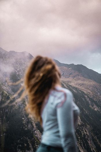 Rear view of woman looking at mountain landscape