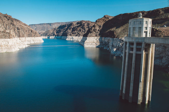 Arizona Beauty In Nature Building Clear Sky Colorado River Concrete Construction Dam Day Electricity  Hoover Dam Hydroelectric Power Lake Mountain Nature Nevada No People Outdoors Reservoir River Scenics Tranquil Scene Tranquility Water Waterfront