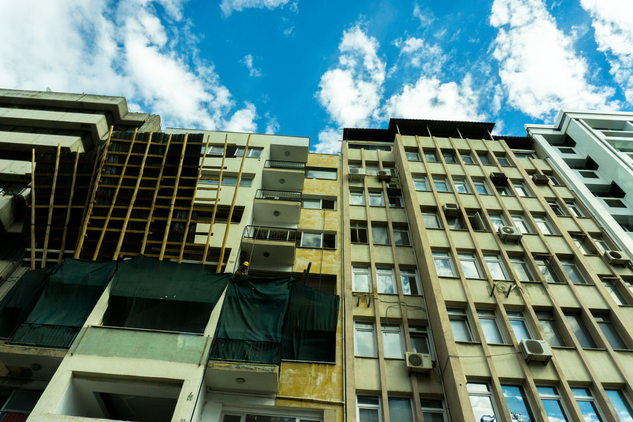 low angle view, architecture, building exterior, window, modern, sky, built structure, outdoors, day, no people, growth, city