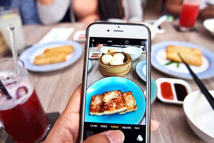 Visual Feast Close-up Human Hand Mobile Phone Smart Phone Portable Information Device Wireless Technology Food And Drink Photography Themes Photographing Food Human Body Part Communication Plate Camera - Photographic Equipment Ready-to-eat Table Holding Real People Photo Messaging Technology Indoors