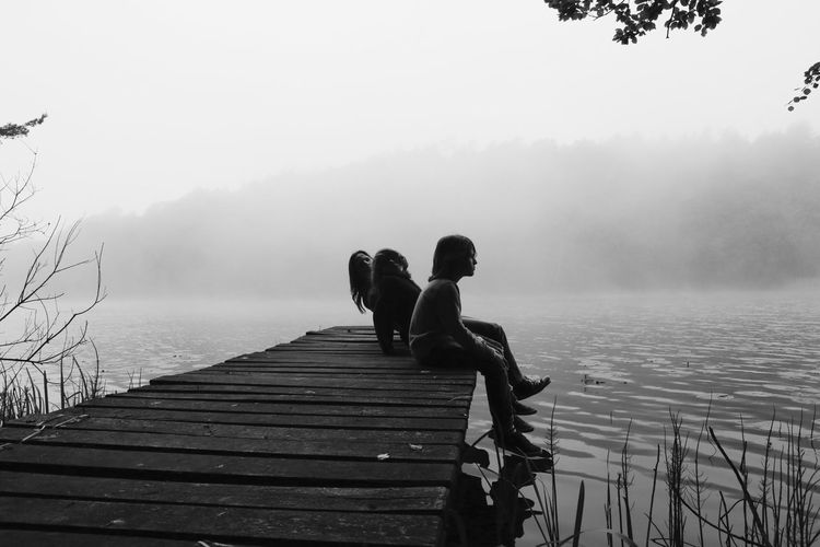 Adult Adults Only Beauty In Nature Day Fog Human Body Part Lake Nature Only Women Outdoors People Rear View Sky Togetherness Tree Two People Water Women Wood - Material