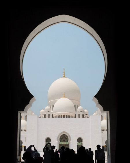 A group of people inside sheikh zayed mosque in abu dhabi