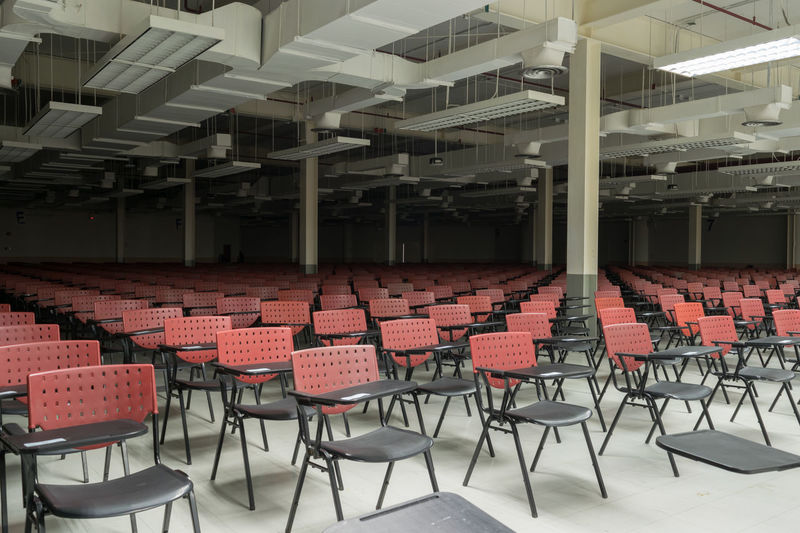 Absence Architecture Arrangement Auditorium Chair Day Education Empty Folding Chair In A Row Indoors  Large Group Of Objects Lecture Hall No People Seat Seminar Table