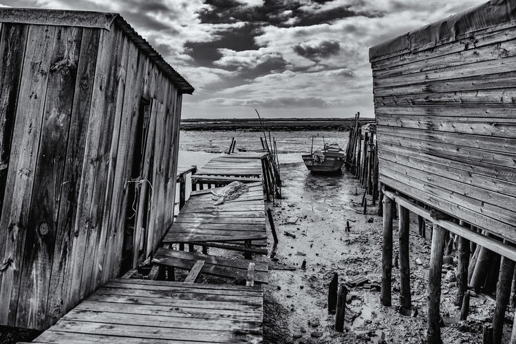 Wooden pier amidst sea against sky
