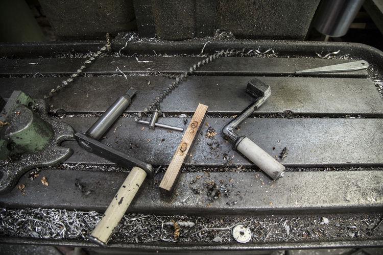 High angle view of work tools on metal table