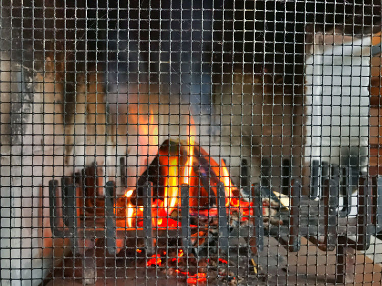 at the fireside Burning Burning Flame Flame Flames Grid Smoke Be On Fire Burn Burning Burning Flames Fire Fire Place Fireplace Fireside Firewood Flame Flames & Fire Flames Burning Fuelwood Heat Heat - Temperature Indoors  Warm Warmth