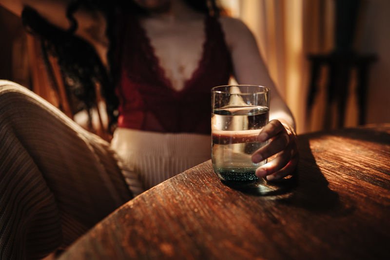 Refreshment Drink Glass Food And Drink Midsection Indoors  Drinking Glass Household Equipment One Person Adult Table Alcohol Hand Human Hand Human Body Part Holding Close-up Women Pint Glass