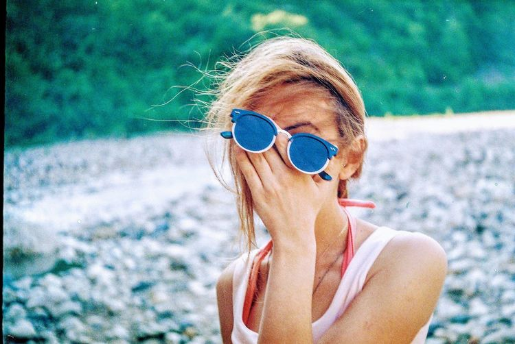 Adult Beautiful Woman Blond Hair Day Fashion Focus On Foreground Glasses Hair Hairstyle Headshot Leisure Activity Lifestyles Nature One Person Outdoors Portrait Real People Sunglasses Women Young Adult Young Women The Portraitist - 2018 EyeEm Awards The Great Outdoors - 2018 EyeEm Awards
