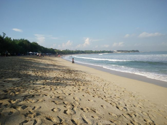 Wide view of Kuta Beach, Bali, Indonesia Beach Beauty In Nature Blue Calm Cloud Cloud - Sky Coastline Day Horizon Over Water Idyllic Nature Non-urban Scene Outdoors Remote Sand Scenics Sea Shore Sky Tourism Tranquil Scene Tranquility Travel Destinations Vacations Water