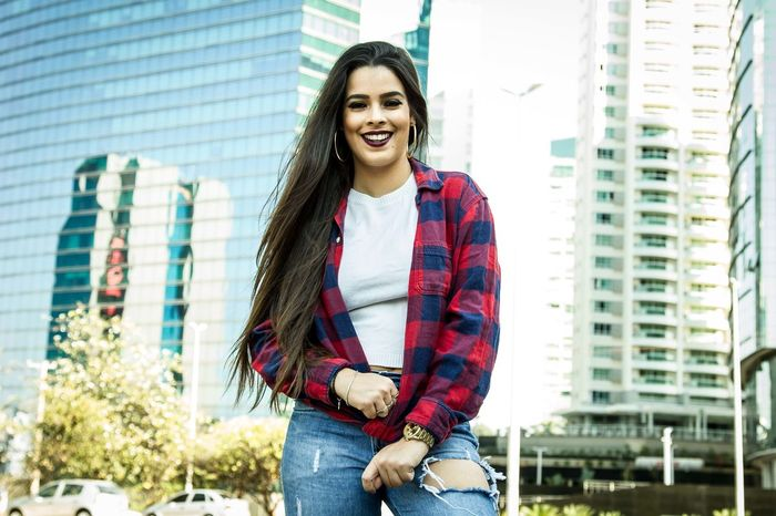Smiley Girl. Smiling Young Adult Toothy Smile Happiness Adult City Adults Only Portrait Cheerful People One Person Looking At Camera City Life Standing Casual Clothing Young Women Only Men One Man Only Day Lifestyles