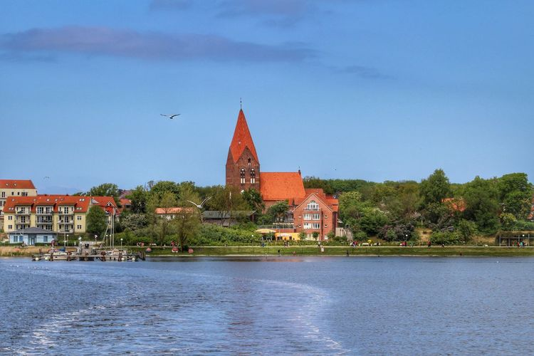 Church In Front Of Baltic Sea Against Sky