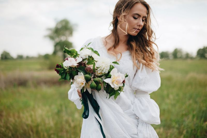 love story of young couple Adult Beautiful Woman Bouquet Day Field Flower Flower Arrangement Flowering Plant Focus On Foreground Front View Hair Hairstyle Land Leisure Activity Nature One Person Outdoors Plant Standing Three Quarter Length Women Young Adult Young Women