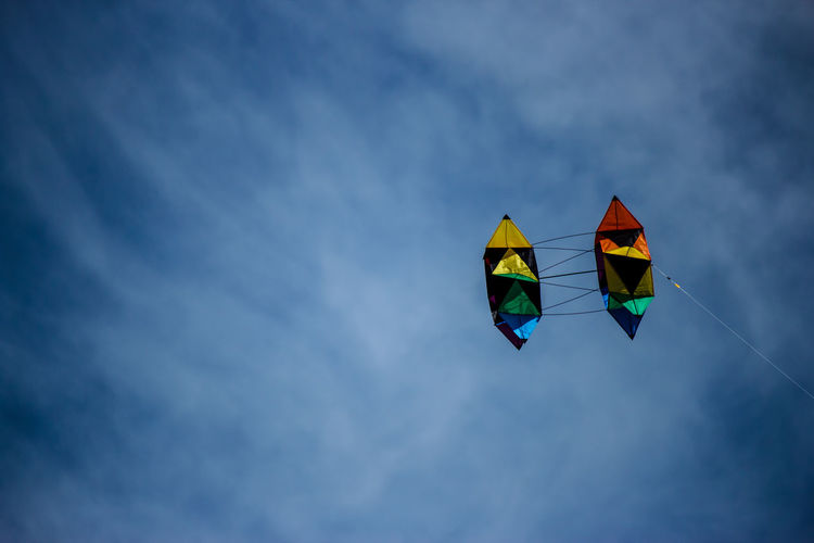 Low angle view of multi colored kites