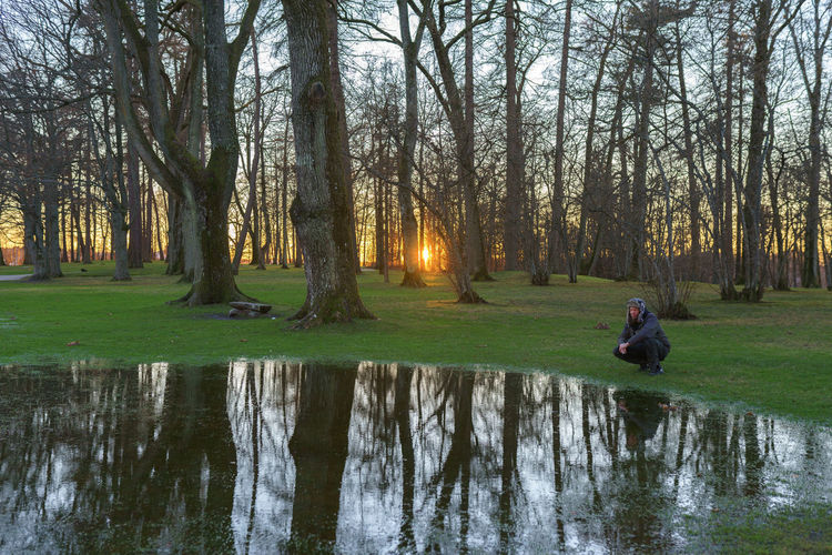 Peace.. ✌️😎 Ice Sunset Park Old Vikings  EyeEm Selects EyeEm Gallery Eyeem Market Tree Water Men Reflection Sky Grass Bare Tree Countryside Lone Calm
