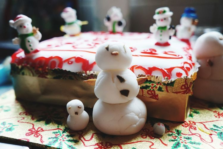 Close-up of christmas cake on table